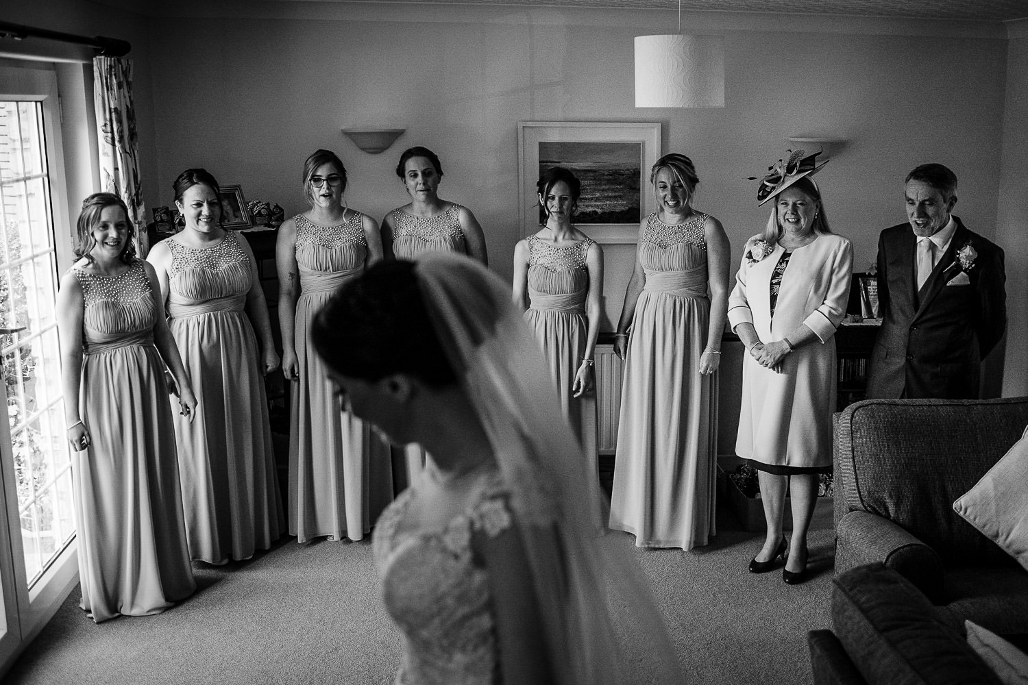 Bride reveals dress to bridesmaids