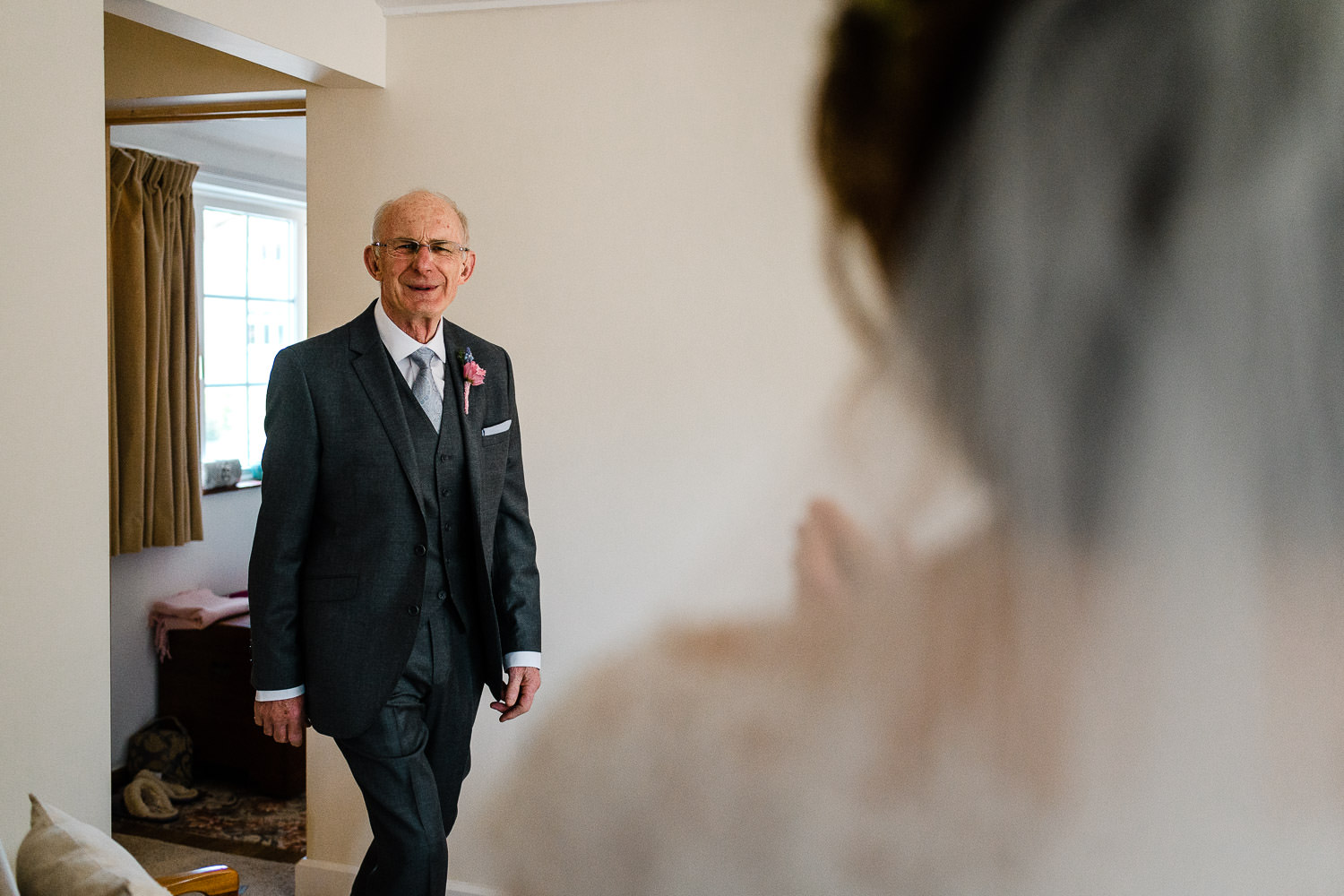 father of the bride's first look at daughters wedding dress