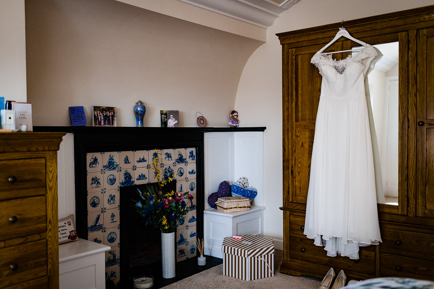 wedding dress hung up at family home