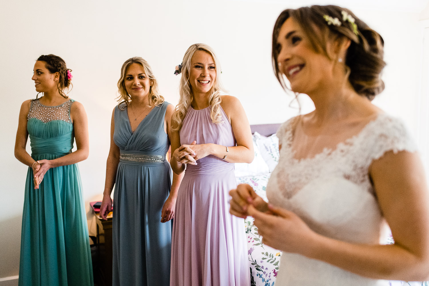 brides dress reveal to bridesmaids