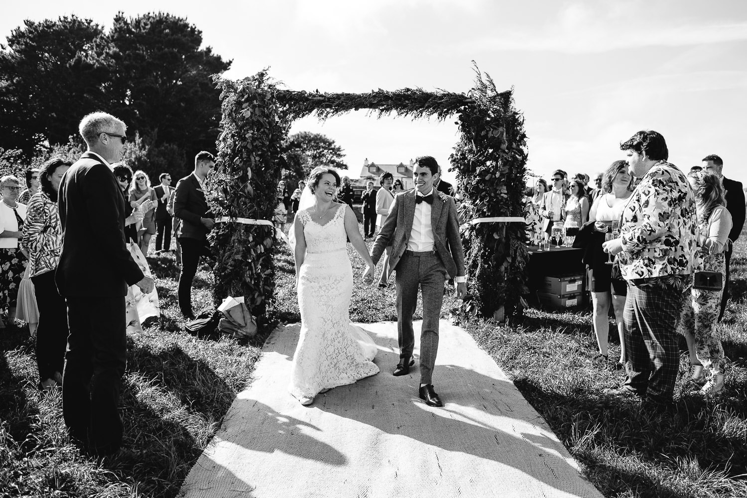 bride and groom entrance to outdoor wedding reception in Cornwall